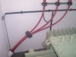 Bracket and piping for transformer bridges